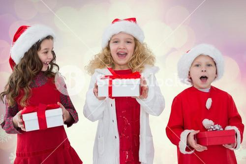 Excited kids holding their gift boxes