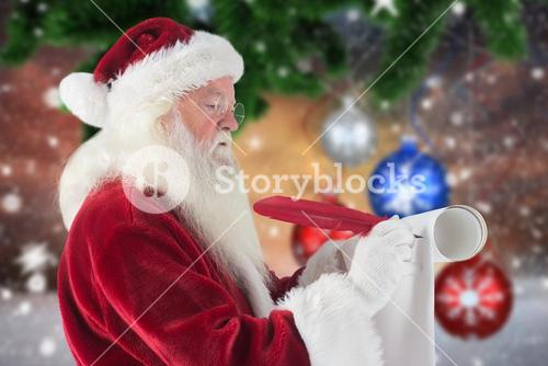 Santa claus writing with a quill