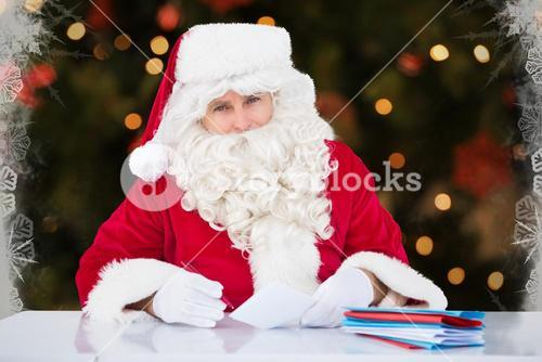 Santa claus sitting while making a check list