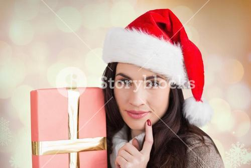 Beautiful woman in santa hat holding a gift