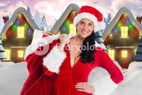 Female santa claus holding a christmas gift sack digitally generated background