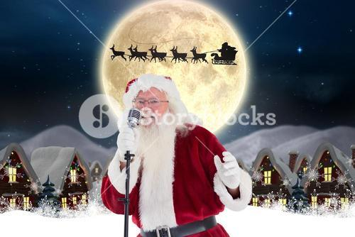 Santa claus singing christmas song in microphone