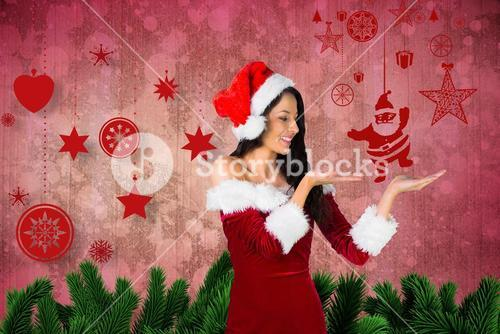 Woman in santa costume pretending to hold imaginary santa claus