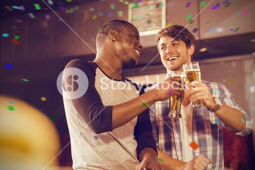 Composite image of happy friends having drink