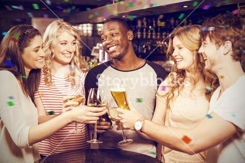Composite image of cheerful friends toasting with beer and wine