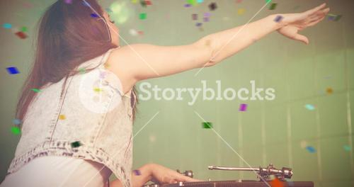 Composite image of female dj playing music while waving hand