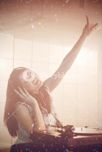 Composite image of pretty female dj with hand raised while listening to music