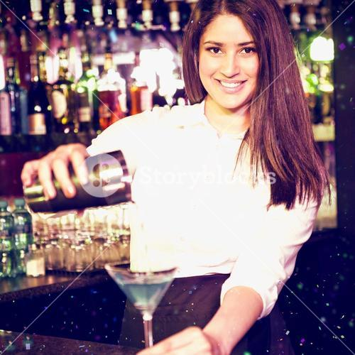 Composite image of portrait of bartender pouring blue martini drink in glass