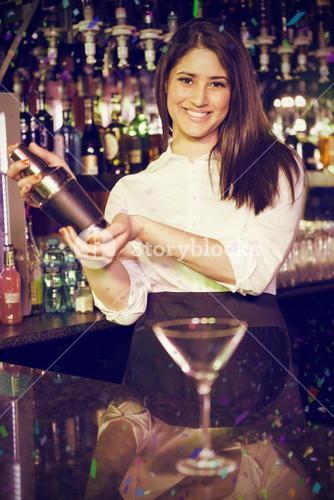 Composite image of portrait of bartender mixing cocktail drink in cocktail shaker