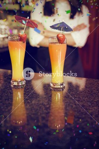 Composite image of two cocktail glasses ready to serve on bar counter