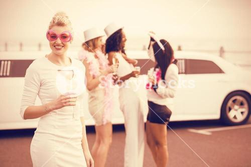 Women with sunglasses holding champagne
