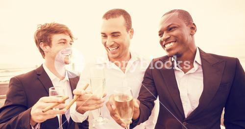 Well dressed men drinking champagne next to limousine