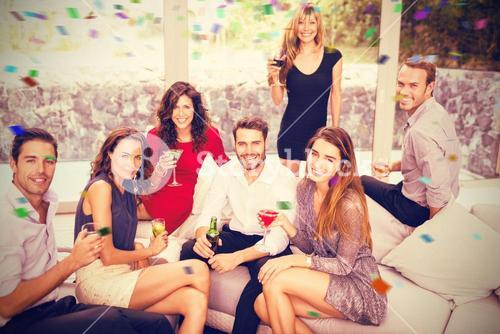 Composite image of portrait of friends having cocktail drinks