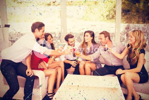 Composite image of group of friends toasting and having drinks