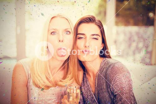 Composite image of portrait of women making funny faces