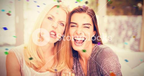 Composite image of portrait of female friends making funny faces