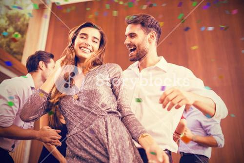 Composite image of cheerful young friends dancing together