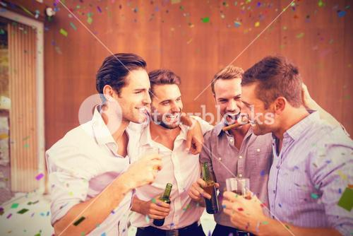 Composite image of group of young men having drinks
