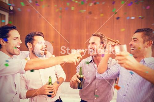 Composite image of group of men having drinks