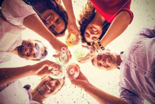 Composite image of directly below shot of friends having cocktail while standing