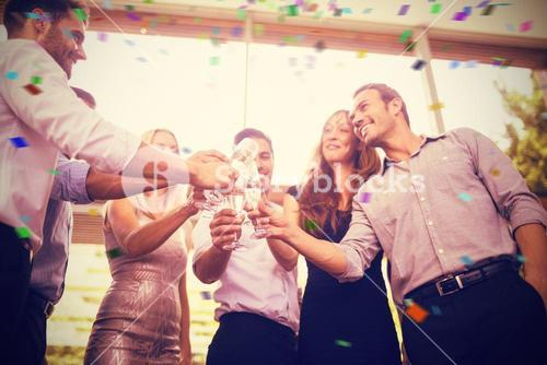 Composite image of low angle view of friends toasting glasses of champagne
