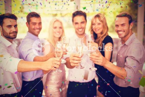 Composite image of group of friends holding glasses of champagne