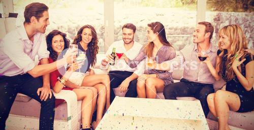 Composite image of friends talking and having drinks