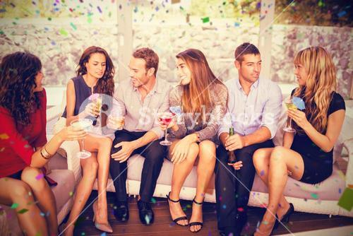 Composite image of group of friends talking and having drinks