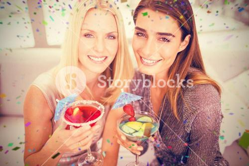 Composite image of portrait of beautiful women having mocktail