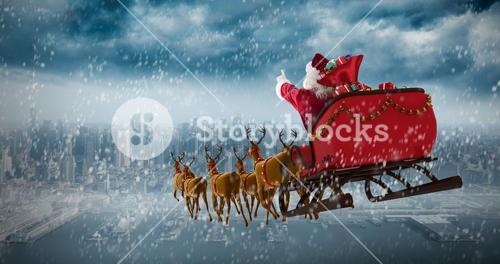 Composite image of santa claus riding on sleigh with gift box