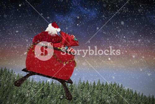 Composite image of rear view of santa claus riding on sled with gift box