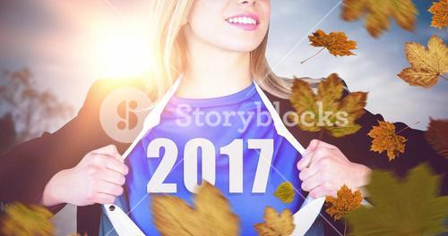 Composite image of businesswoman opening shirt in superhero style