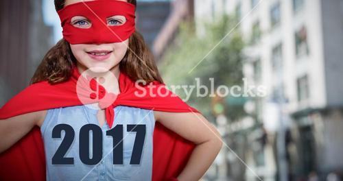 Composite image of little girl pretending to be a superhero