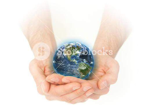 Masculine hands holding the Earth