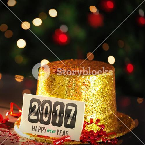 Happy new year card leaning on gold party hat