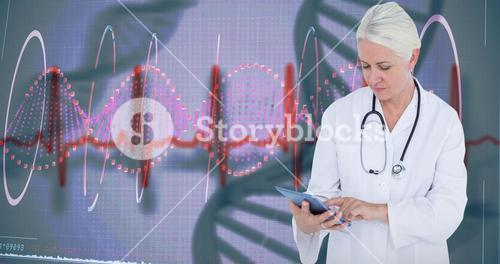 Composite image of female doctor using table computer