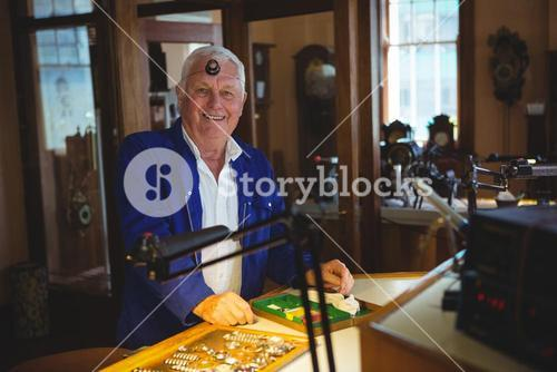 Portrait of smiling horologist