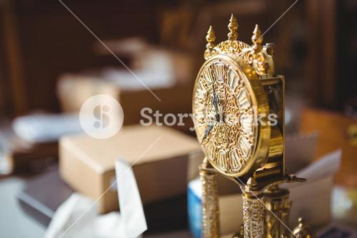 Close-up of golden watch on table