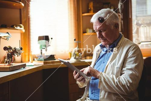 Horologist using digital tablet