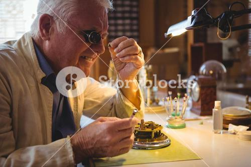 Horologist repairing a watch
