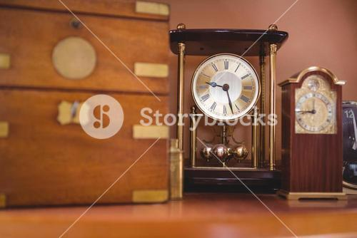 Pendulum clock watch on table