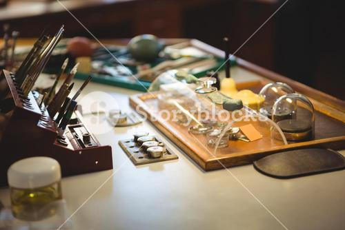 Horologist work tools and equipment on desk