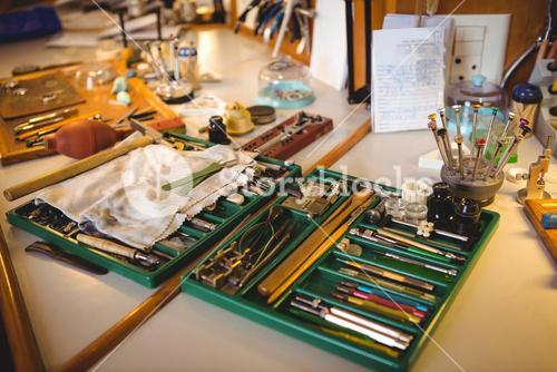Horologist workshop with clock repairing tools, equipments and machinery