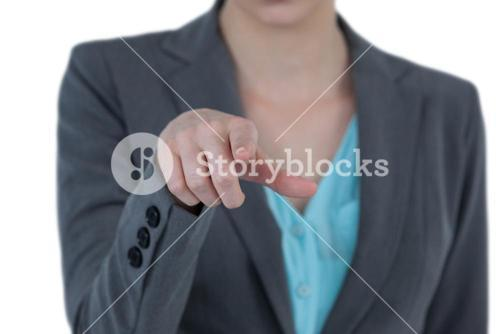 Mid section of businesswoman using digital screen