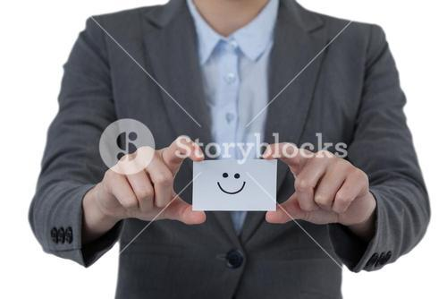 Businesswoman holding visitor card with smiley