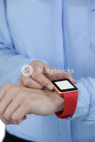 Businesswoman using smartwatch