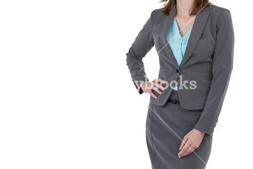 Mid section of businesswoman with hands on hip
