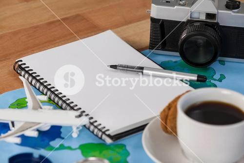 Holiday and tourism conceptual image with travel accessories and cup of coffee