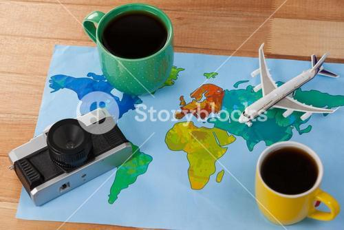 Holiday and tourism conceptual image with travel accessories and coffee mugs