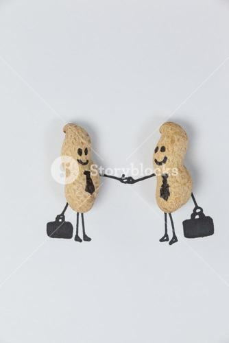 Figurine of two businessmen shaking hands